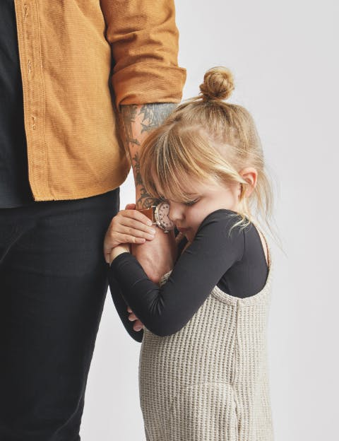 Man wearing Shinola watch and holding his daughter's hand