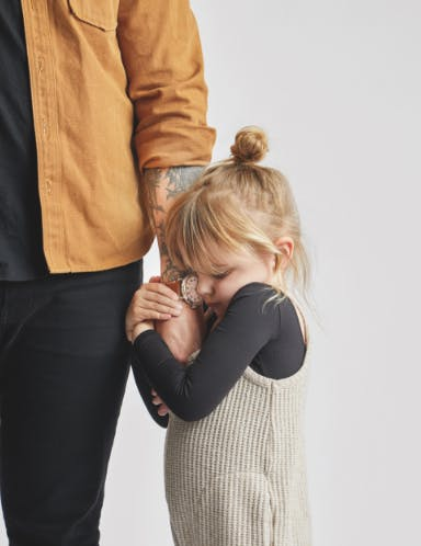 Little girl holding her dad's hand