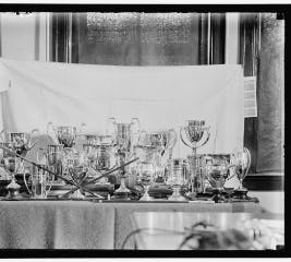Black and white photo of a collection of trophies