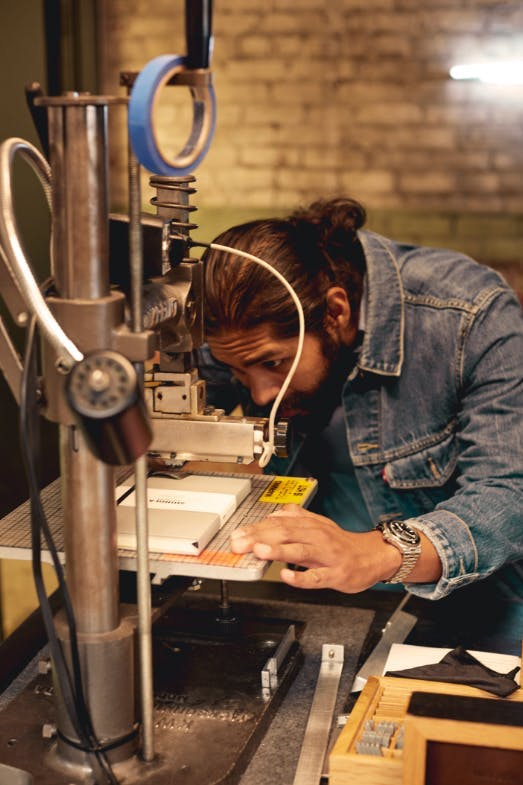 Shinola Employee Working With Heavy Machinery