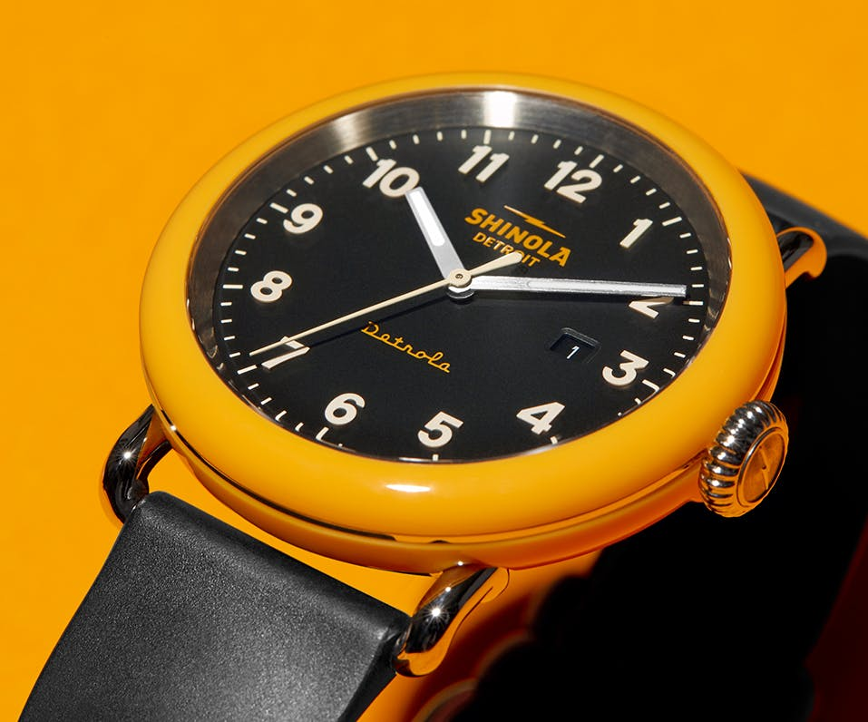 Close-up of the No.2 Detrola watch with an orange dial and black face