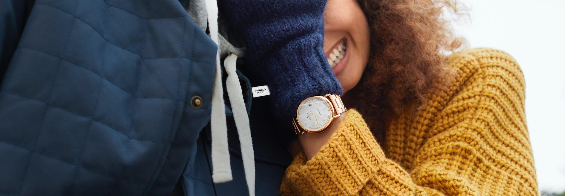Woman smiling, wearing a Shinola watch