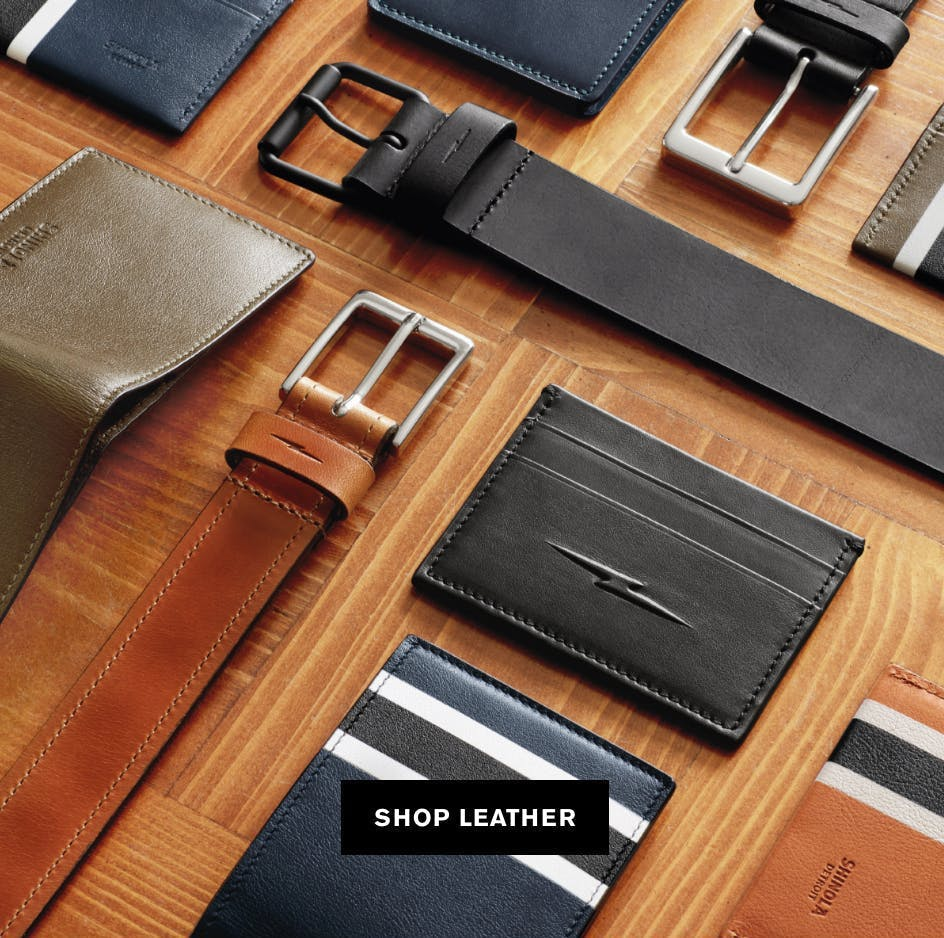 Picture of men's leather belts, wallets and card cases
