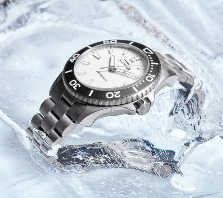 Ice Monster watch partially frozen in ice