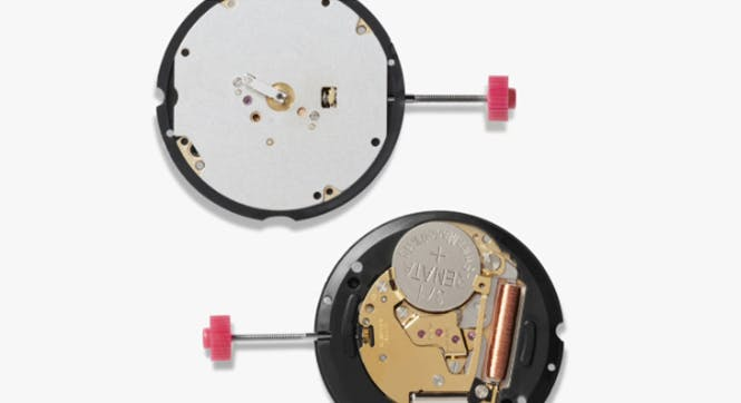 Inside-look of the backside of the watch revealing the parts and different mechanisms.