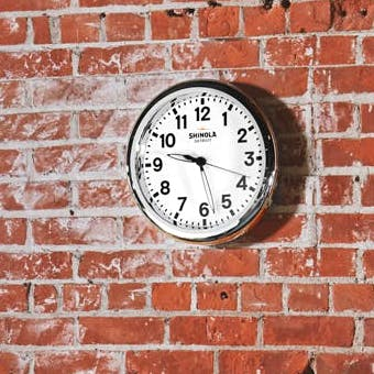 White Runwell Clock on a Brick Wall