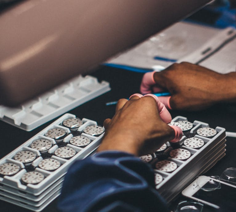 Shinola employee working on watches